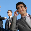 Junior businessman on the phone outdoors — Stock Photo