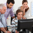 Stock Photo: Colleagues looking at computer