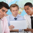 Royalty-Free Stock Photo: Young businessmen having a meeting