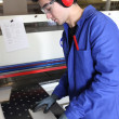 Factory worker wearing ear defenders — 图库照片
