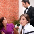 Stock Photo: Wine waiter showing a sparkling wine bottle to customers