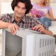 Man fixing an old television — Stock Photo #7914732