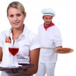 Young working in a restaurant — Stock Photo