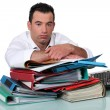 An overworked office worker — Stock Photo