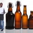 Stock Photo: Waiter with beer bottles