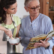 Mother and daughter cooking together - Foto de Stock