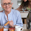 Stock Photo: Womserving breakfast to another woman