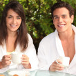 Couple having breakfast outside — Stock Photo