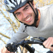 Man riding his bike - Stock Photo