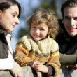 Young family in the countryside — Stock Photo #7915722
