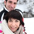 Couple walking in snow - Stockfoto
