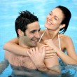 Couple hugging in swimming pool — Stock Photo #7915768