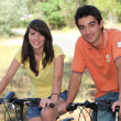 Teenagers doing bike in forest — Stock fotografie
