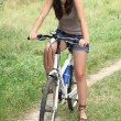 Young woman doing mountain bike in the country — Stock Photo #7915983