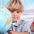 Kid learning geography. - Stock Photo