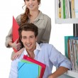 Young couple in library — Foto Stock