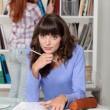 Two women studying in library — Stock Photo