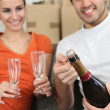 Couple opening bottle of champagne — Stock Photo #7916399
