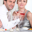 Romantic couple enjoying rose wine with dinner — Stock Photo