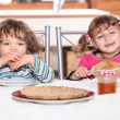 Portrait of two kids at breakfast — Stock Photo