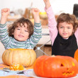 Brother and sister calving pumpkins — Stock Photo