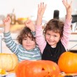 Stock Photo: Children carving pumpkins