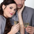 An elegant couple celebrating with a toast — Stock Photo #7916669