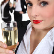 Businesswoman drinking champagne — Stock Photo