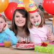 Little girls with mom at birthday party — Stock Photo