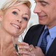 Mature couple drinking champagne — Stock Photo #7916704