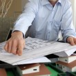Architect with plans and model — Stock Photo