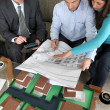 Young couple looking over new house plans — Stock Photo #7916760