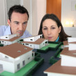Royalty-Free Stock Photo: Couple looking at a model of a housing estate