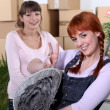 Stock Photo: Two women moving house
