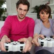 Youngsters playing video games — Stock Photo