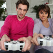 Youngsters playing video games - Stockfoto