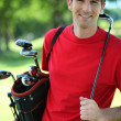 Golfer carrying clubs. — Stock Photo #7917109