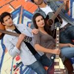 Musical trio against graffiti wall — Stock Photo