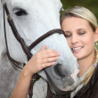 Woman and horse — Stock Photo #7917561