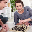 Couple play chess — Stock Photo
