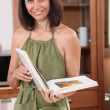 Woman reading a recipe — Stock Photo