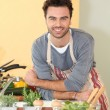 Man cooking at home — Stock Photo