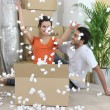 Couple amid boxes — Stock Photo