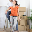 Couple happy to have finally moved into new flat — Stock Photo #7919227