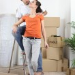 Couple happy to have finally moved into new flat — Stock Photo
