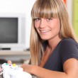 Blond teenage girl with video game controller — Stock Photo #7919408