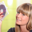 Portrait of a woman holding CDs — Stock Photo #7919431