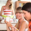 Girls having breakfast — Stock Photo