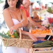 Woman shopping at local market — Stock Photo