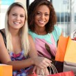 Stock Photo: 2 friends shopping